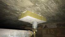 Progress shot of Intubatt fill around metal pipe through slab.